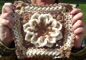 A brown and white crocheted square